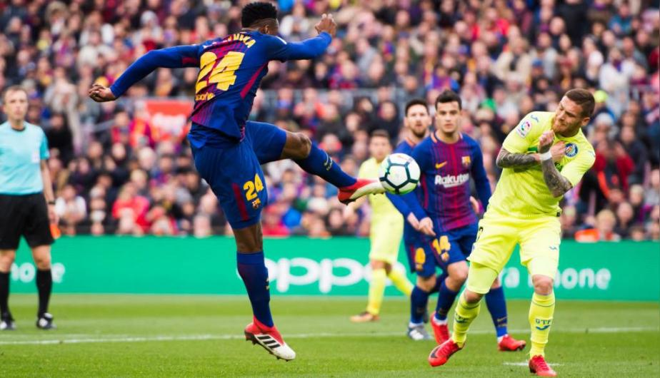 El defensor Yerry Mina disputó los 90' del empate entre FC Barcelona y Getafe. (Foto: Getty Images)
